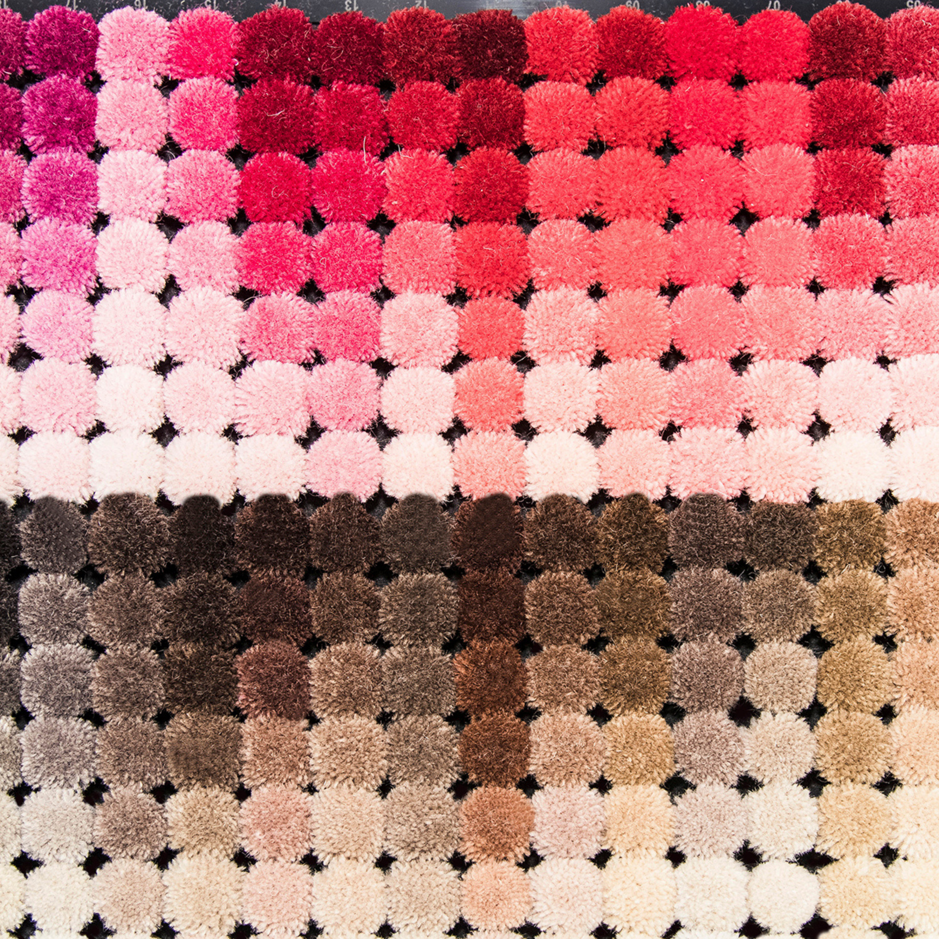 Luxury Carpet Studio Collections are aimed to inspire and show the wide range of possibilities in colours, yarns, shapes and design our designers offer. Our Pom Pom Box shows an example of all the colours and shades we can use to create a tailor made luxury carpet.